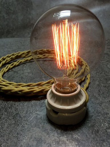"BULB: GLOBE STYLE WITH CAGE FILAMENT, 40W - 3.13"" diameter, medium base, lit"