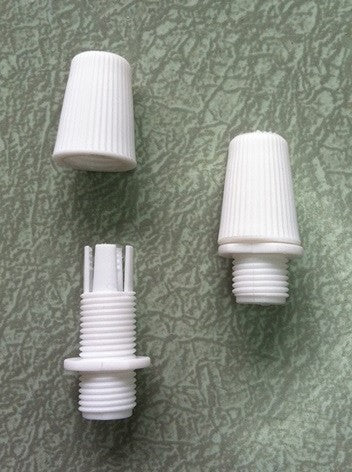 white plastic screw top strain relief for cloth-covered wire