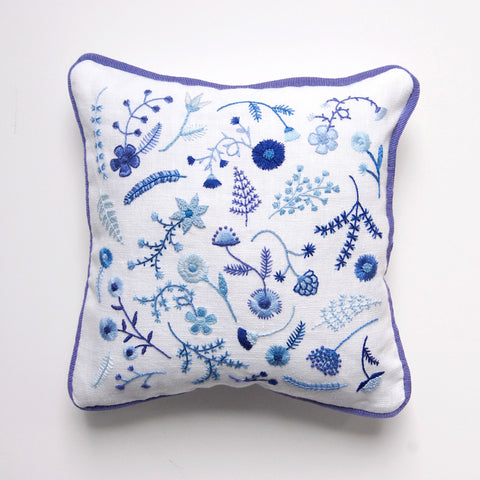 https://www.happycactusdesigns.com/products/hand-embroidered-blue-flowers-pillow