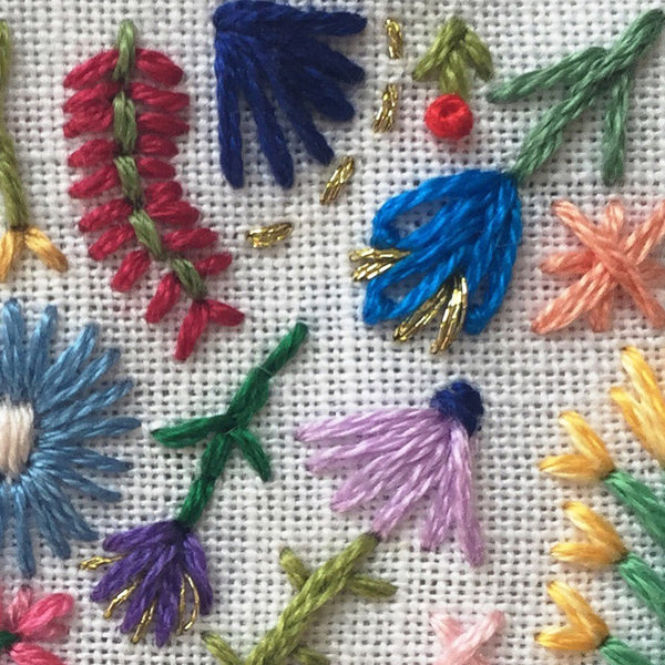 Happy Cactus Designs hand embroidered flowers with embroidery floss and gold thread