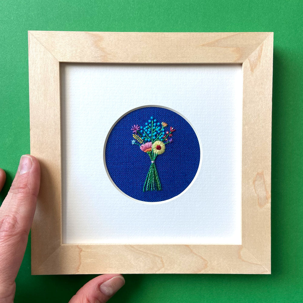 Rainbow Bouquet on Bright Blue Linen Hand Embroidered Art