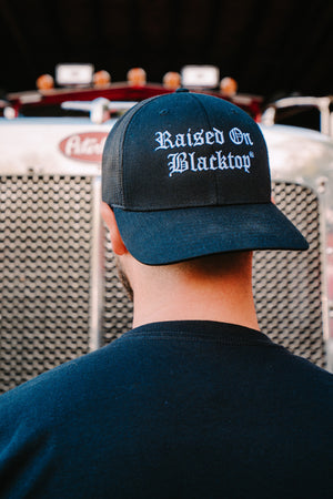 RAISED ON BLACKTOP TRUCKER HAT