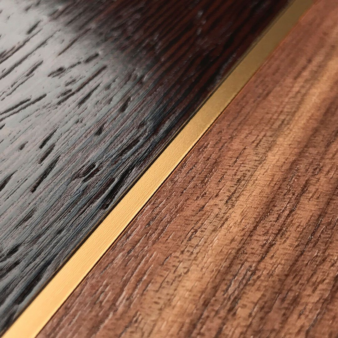 Zoomed in detailed shot of the Alium Walnut, Gold, and Wenge Elegant Wood iPhone X Case by Keyway Designs