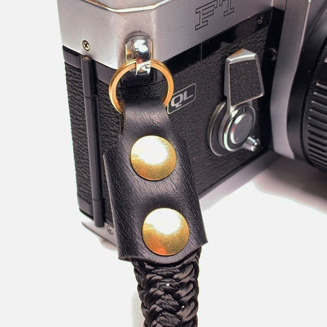 Camera Neck Strap. Black Leather, Brass and Black Nylon. Precision cut leather and solid brass hardware.