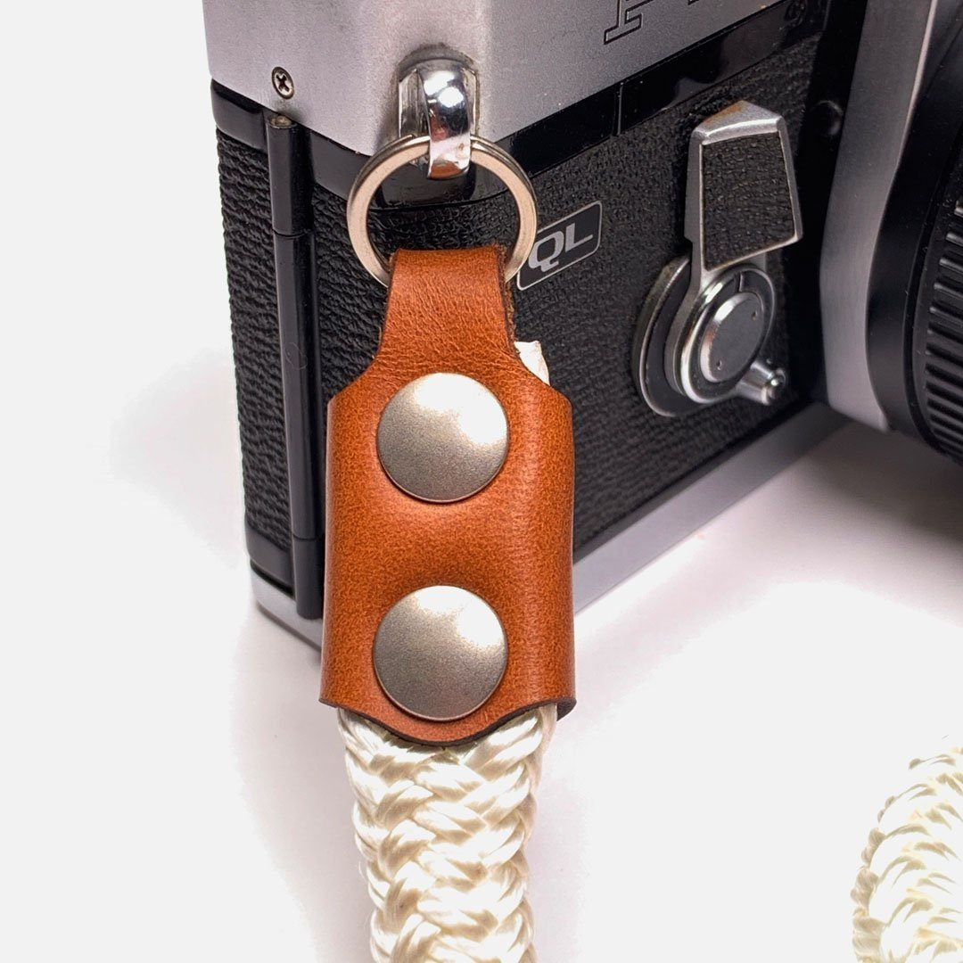 Camera Neck Strap. Leather, Brass and Nylon. Precision cut leather fixtures and Solid Brass & Iron hardware.