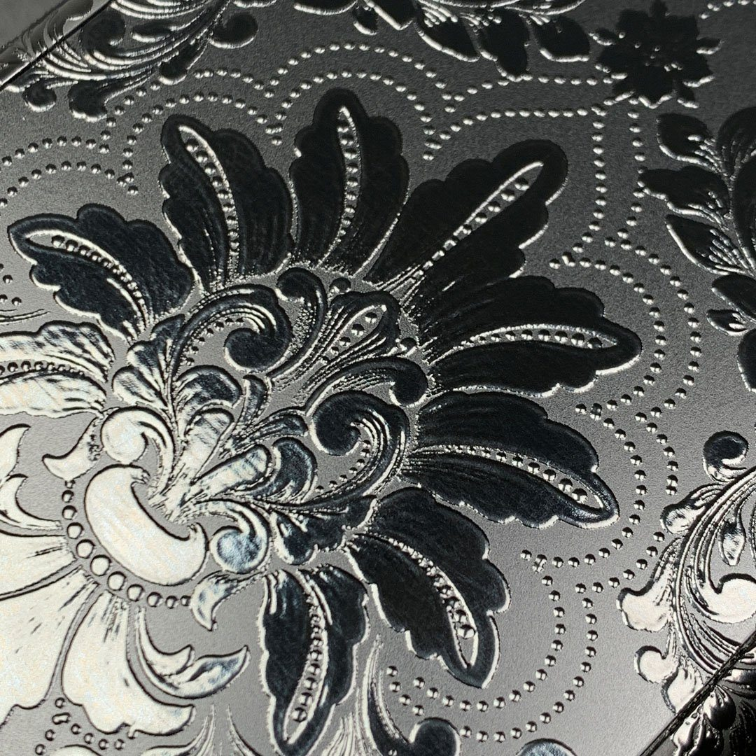 Zoomed in detailed shot of the detailed gloss Damask pattern printed on matte black impact acrylic iPhone 11 Pro Case by Keyway Designs