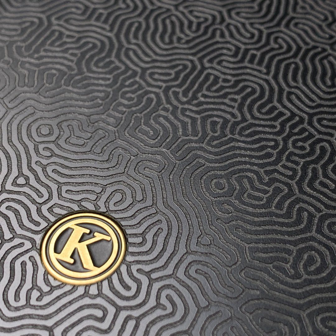 Zoomed in detailed shot of the highly detailed organic growth engraving on matte black impact acrylic iPhone 11 Pro Case by Keyway Designs
