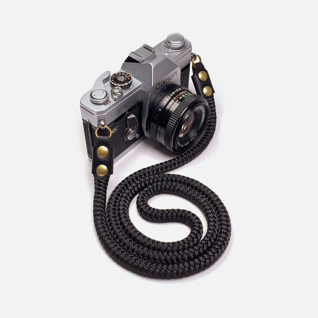 Camera Neck Strap. Black Leather, Brass and Black Nylon. Designed and Produced in Canada by Keyway Designs.