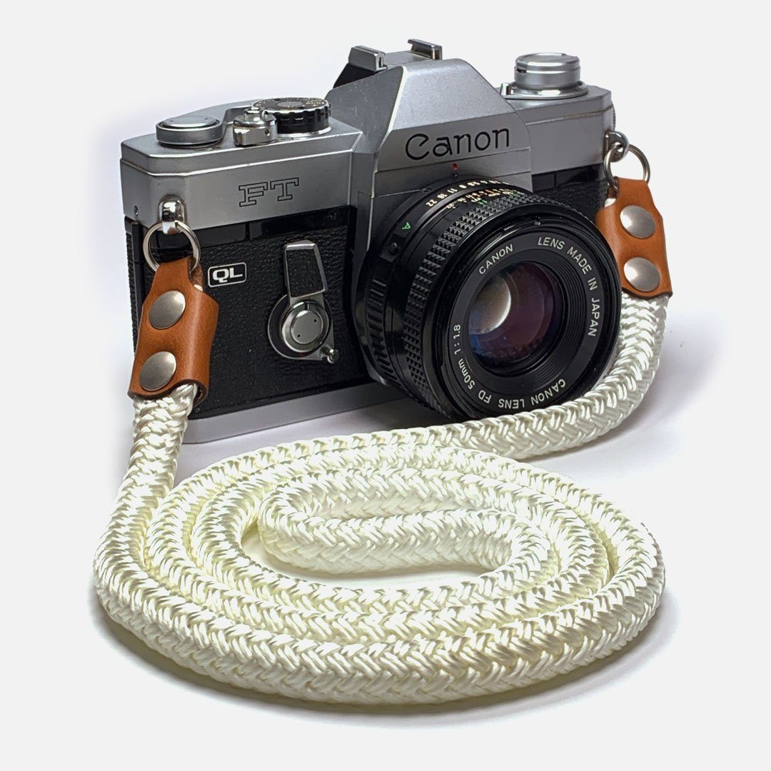 Camera Neck Strap. Leather, Brass and Nylon. Designed to hang below the chest.