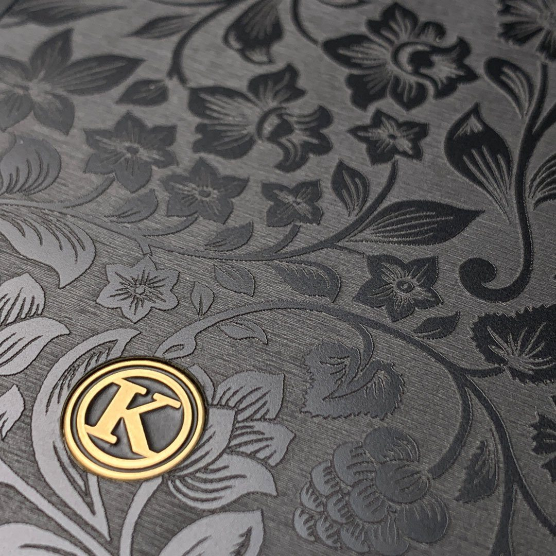 Zoomed in detailed shot of the highly detailed midnight floral engraving on matte black impact acrylic Galaxy Note 9 Case by Keyway Designs