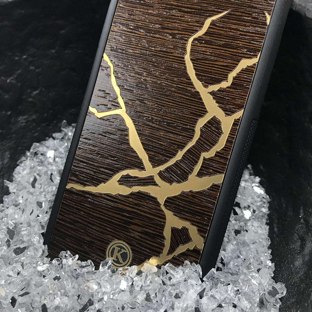 Zoomed in detailed shot of the Kintsugi inspired Gold and Wenge Wood Galaxy S10 Case by Keyway Designs