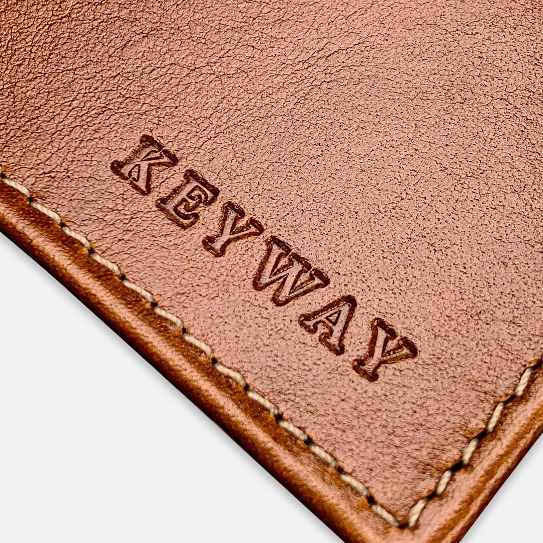 Keyway Full-grain Leather Passport Wallet, Whiskey, detailed view of embossing