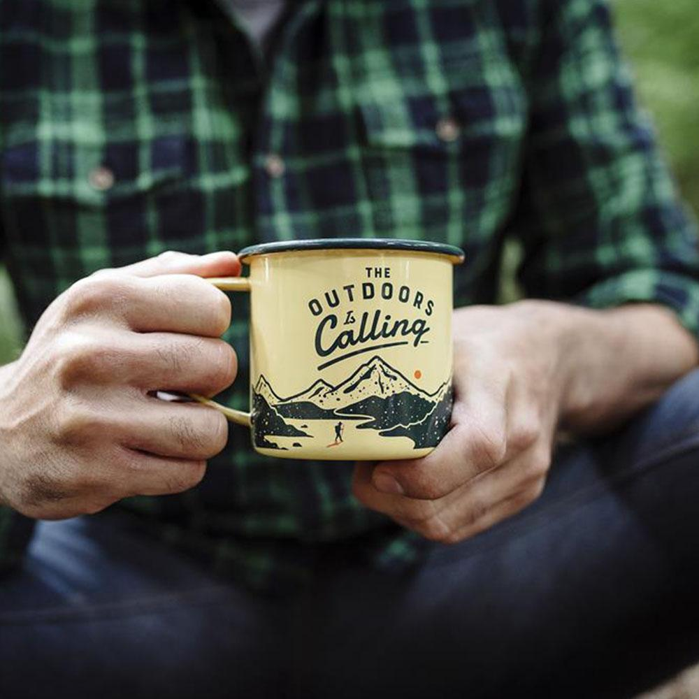 Wild+Wolf - Outdoors is Calling mug by the campsite