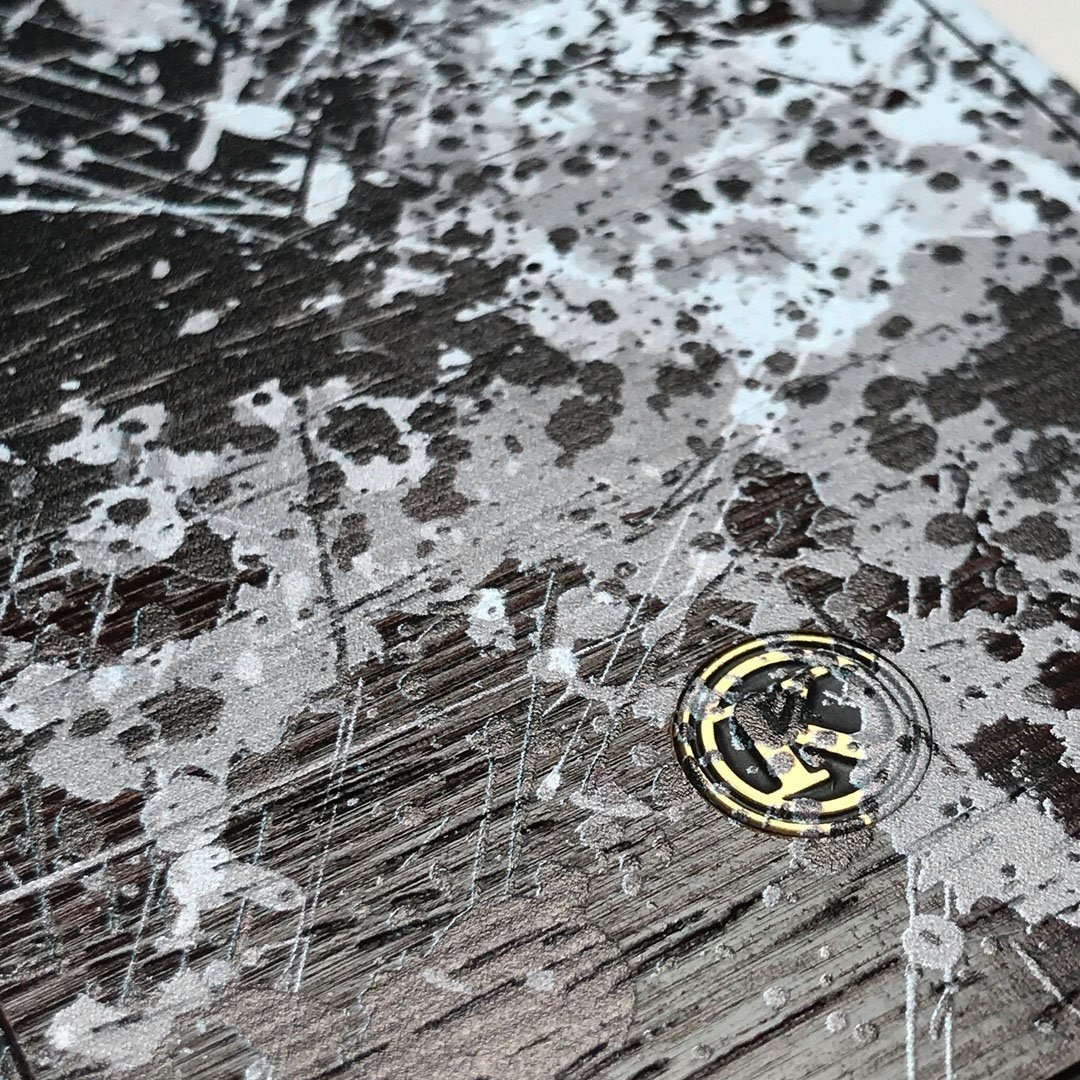 Zoomed in detailed shot of the aggressive, monochromatic splatter pattern overprintedprinted Wenge Wood iPhone X Case by Keyway Designs