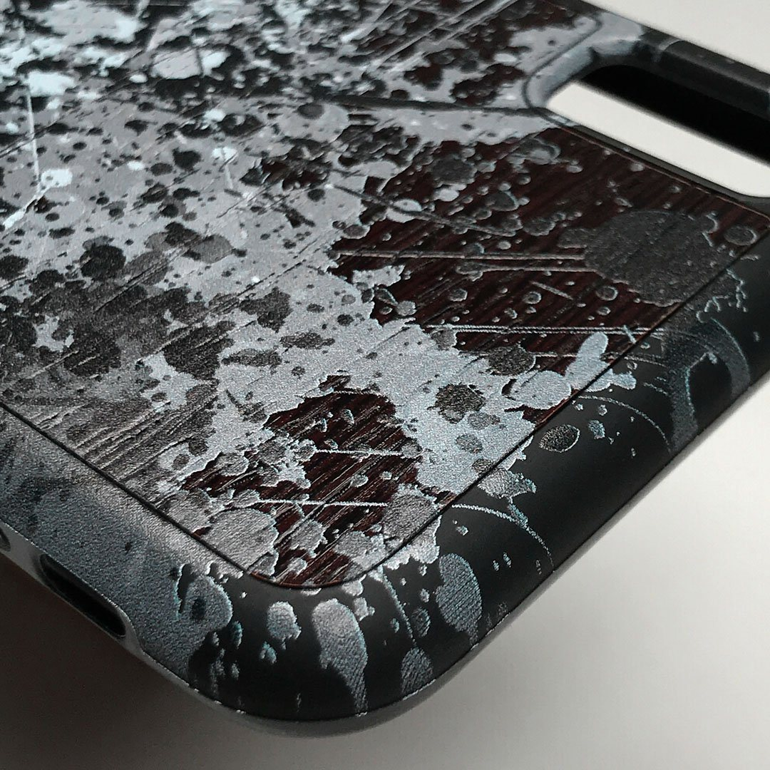 Zoomed in detailed shot of the aggressive, monochromatic splatter pattern overprintedprinted Wenge Wood iPhone 7/8 Plus Case by Keyway Designs