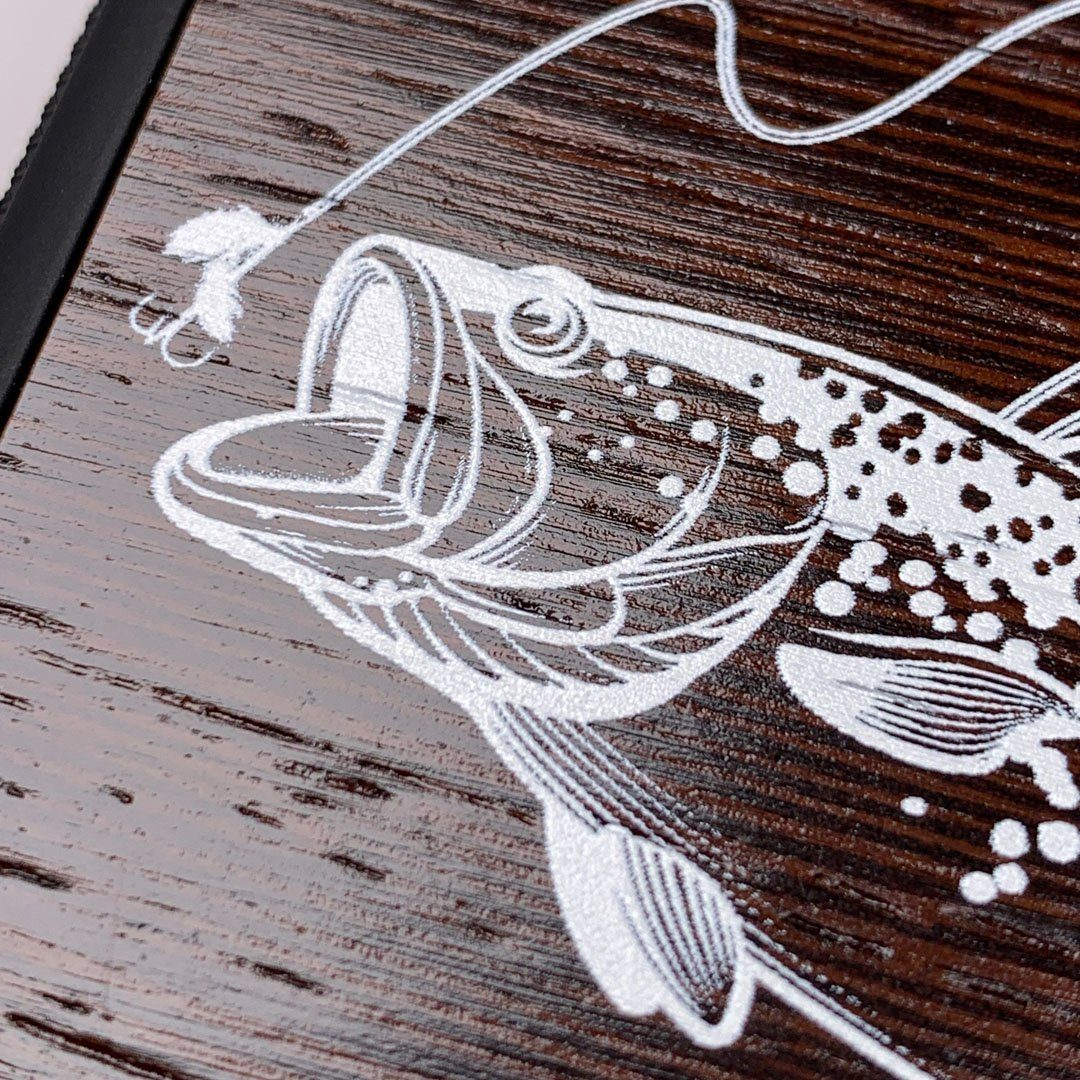 Zoomed in detailed shot of the high-contrast spotted bass printed Wenge Wood iPhone 7/8 Case by Keyway Designs