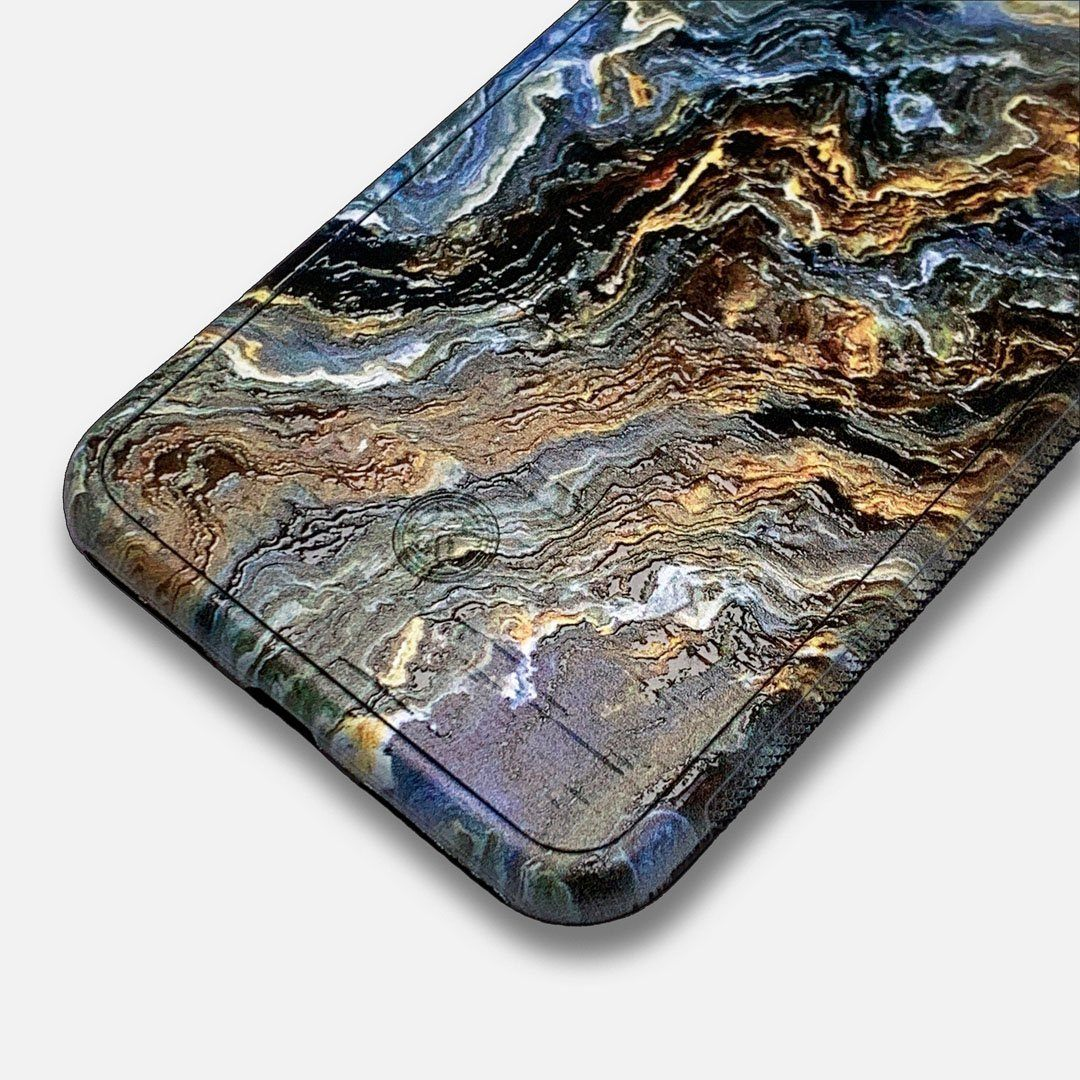 Zoomed in detailed shot of the vibrant and rich Blue & Gold flowing marble pattern printed Wenge Wood iPhone 11 Case by Keyway Designs