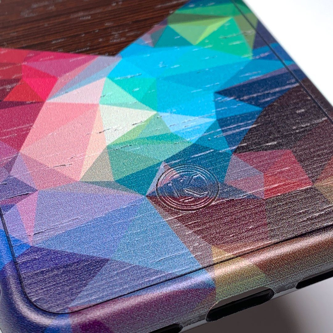 Zoomed in detailed shot of the vibrant Geometric Gradient printed Wenge Wood iPhone X Case by Keyway Designs
