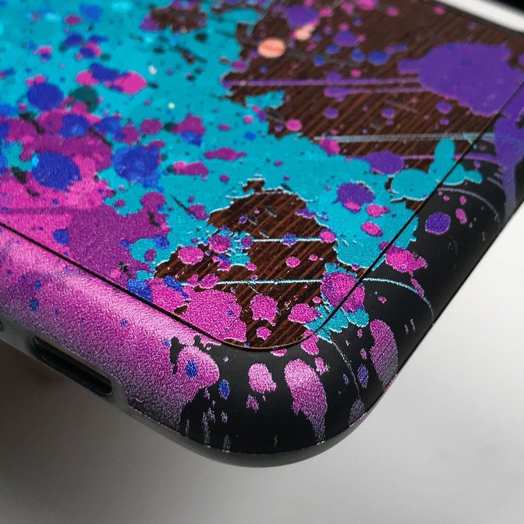 Zoomed in detailed shot of the realistic paint splatter 'Chroma' printed Wenge Wood iPhone 11 Case by Keyway Designs