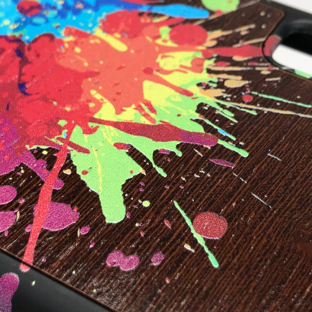 Zoomed in detailed shot of the illustration-style paint drops printed Wenge Wood iPhone 7/8 Case by Keyway Designs