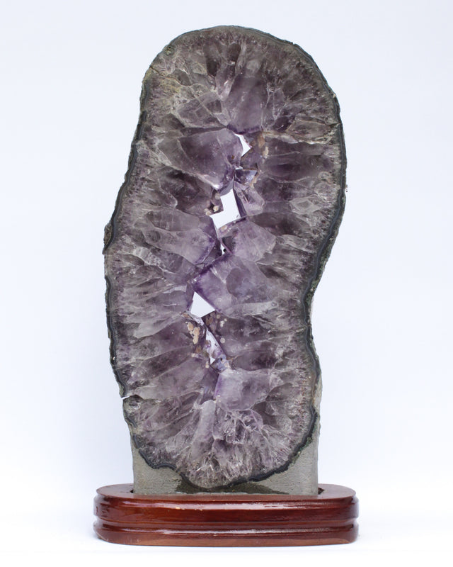 Amethyst slice with calcite deposits and a baroque natural forming pearl.