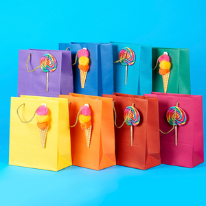 green-gift-bag-with-ice-cream-pom-poms-dylans-candy-bar