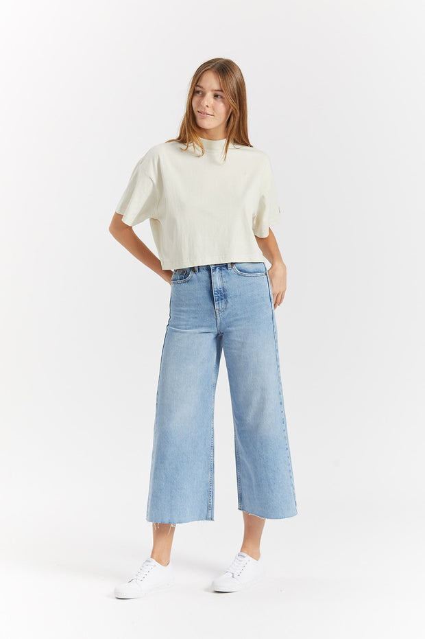 Dr Denim Jeans Australia & NZ - The Jana Tee Pinfire is a high neck, cropped womens tee with a boxy fit and dropped shoulder in a soft off white fabric. It adds an urban flavour to our women's tops range. Buy online now, or shop more women's clothing...
