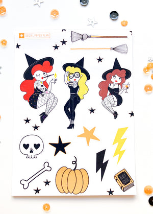 Sticker sheet with three witches, two brooms, pumpkins, lightening bolts, bones, skulls, stars, spell books