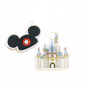 This Disney inspired princess castle is an acrylic charm.  It is printed and clear border around the design. Perfect for any project with the ability to place a charm, you can add it to a keychain, to a necklace, to a bracelet, a zipper pull, on a backpack, add it to a purse.  It is small enough in size to use as an accessory or jewelry.