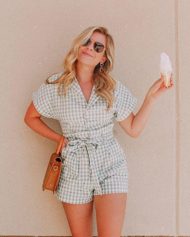 woman in green gingham romper holding ice cream cone
