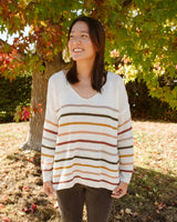 cream lightweight sweater with rainbow multicolor stripes