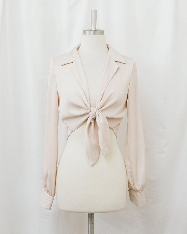 mannequin wearing knot front satin collared top