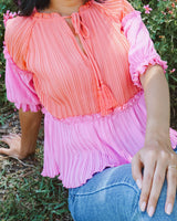 pleated hot pink and coral blouse