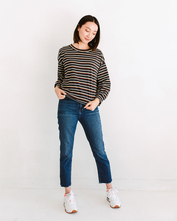 model wearing vintage wash multicolor striped cropped long sleeve top