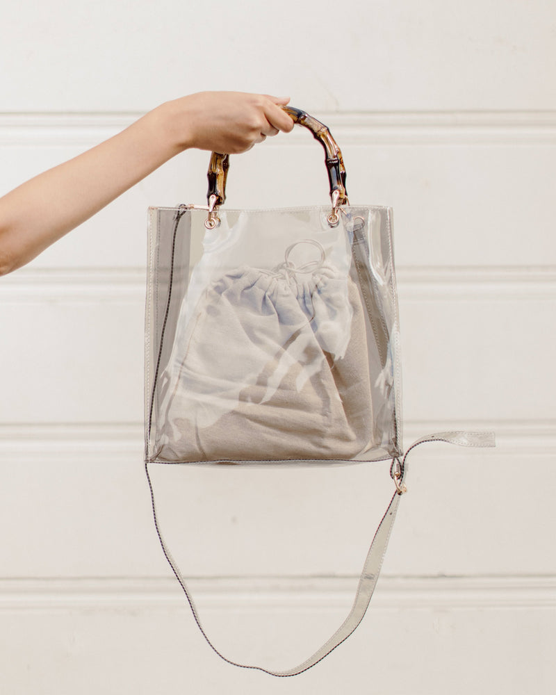 clear gray PVC rectangle bag with bamboo top handle and canvas drawstring insert