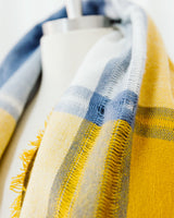 close up yellow cream and blue plaid blanket scarf
