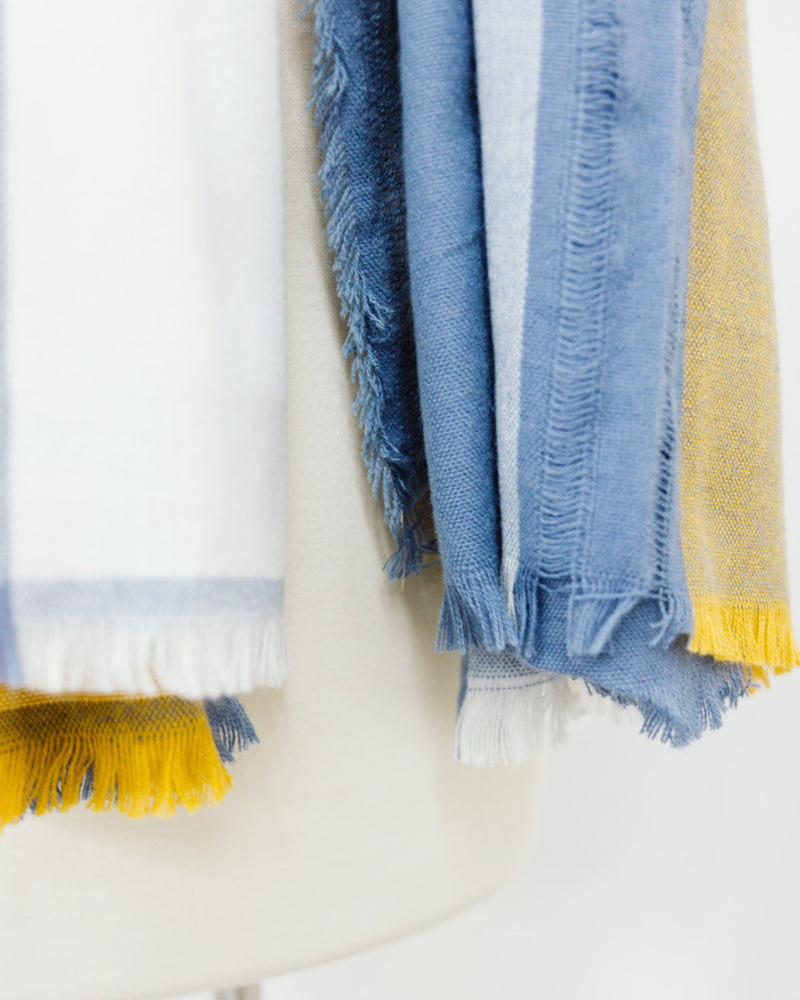 fringe detail yellow cream and blue plaid blanket scarf