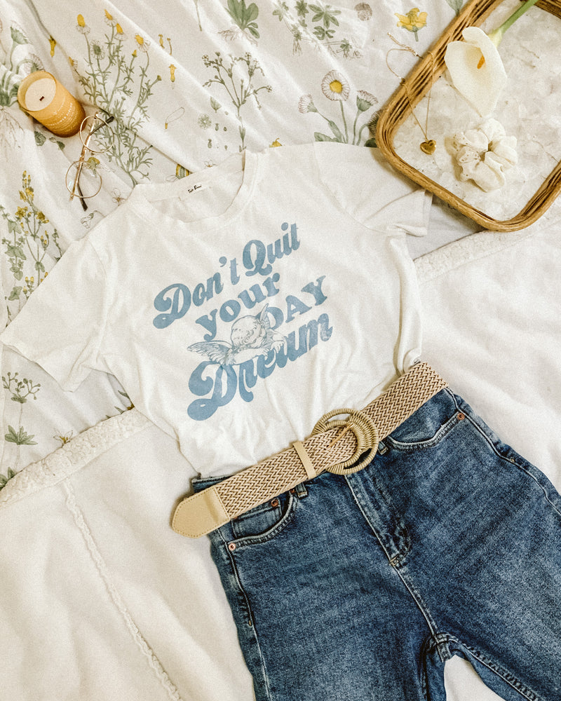 flatlay of don't quit your daydream cherub angel graphic tee