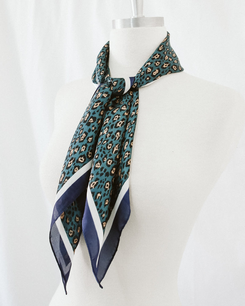 teal and navy cheetah print silk scarf with white border