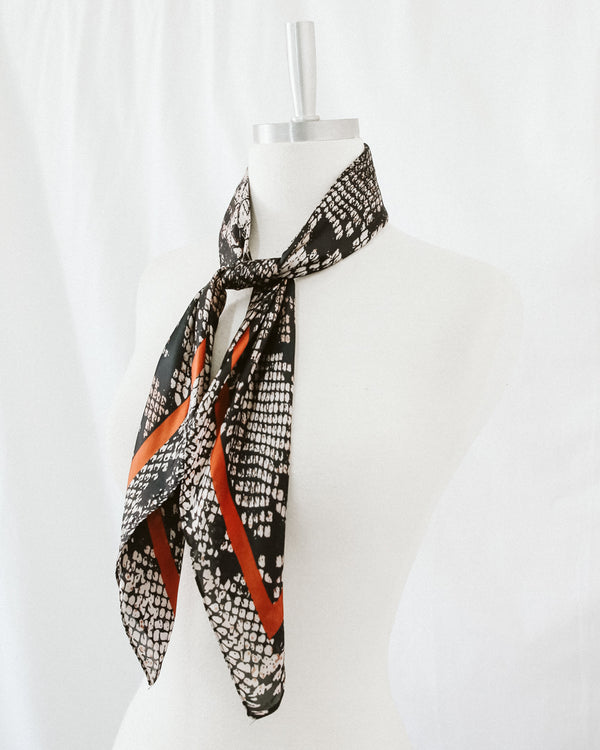 beige and black snake skin silk scarf with rust orange border