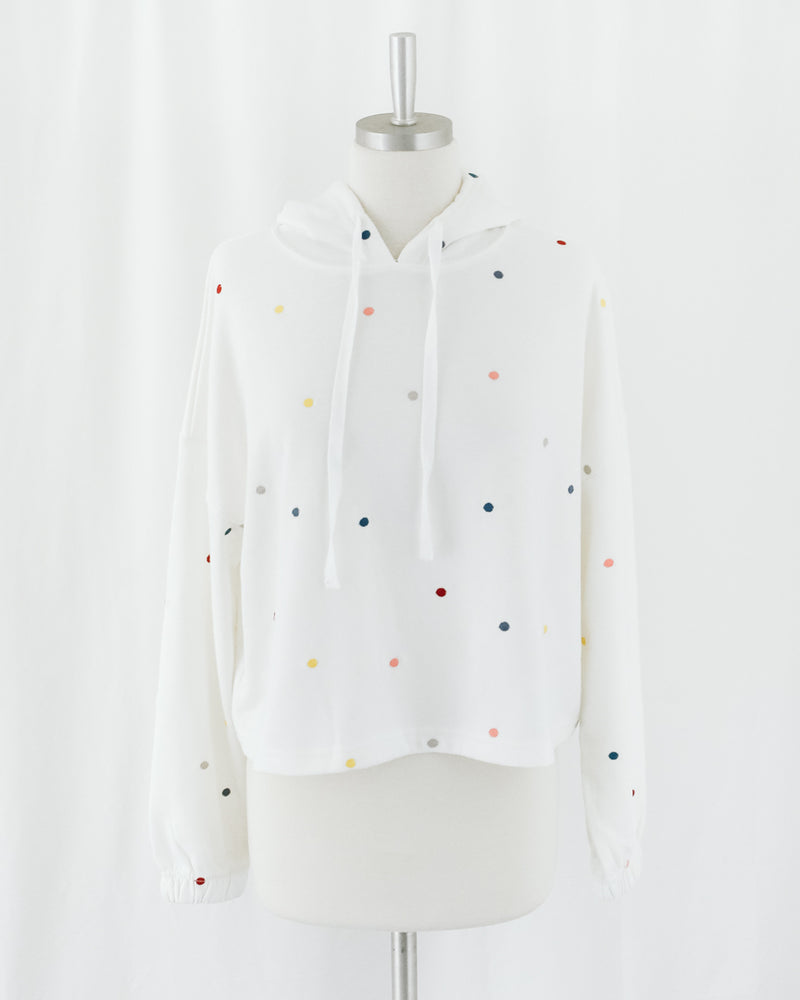 white pullover sweater hoodie with embroidered polka dots