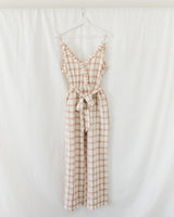 v-neck spaghetti strap plaid jumpsuit with ruffles and waist tie