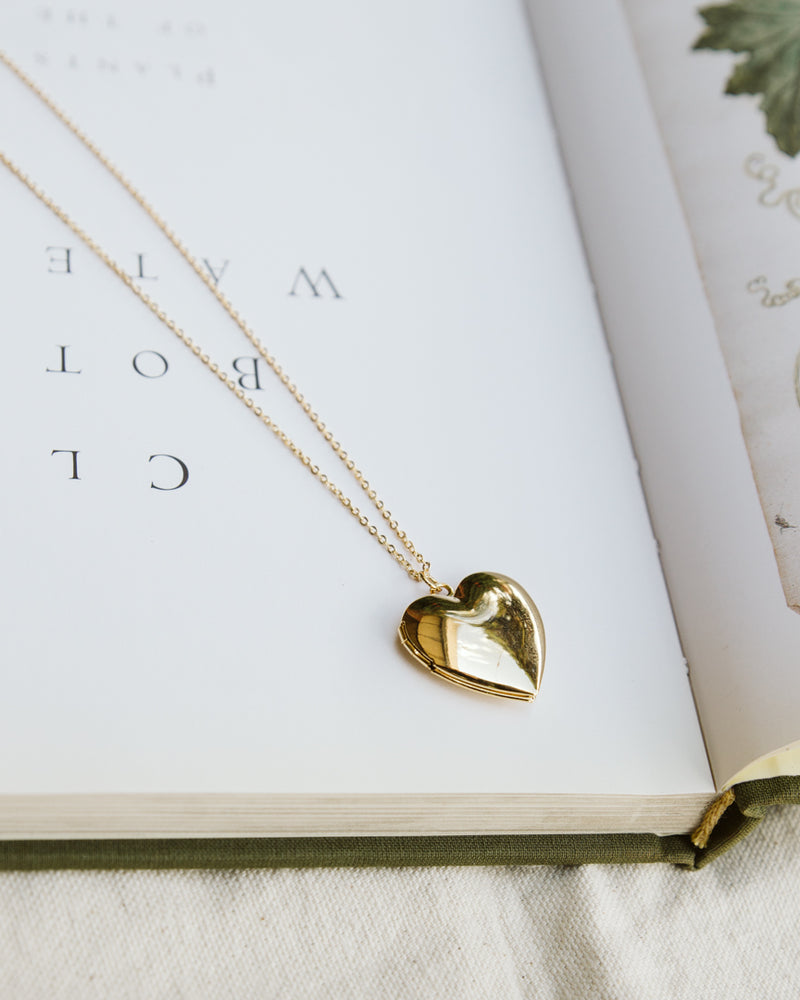 chunky gold heart locket necklace on delicate chain