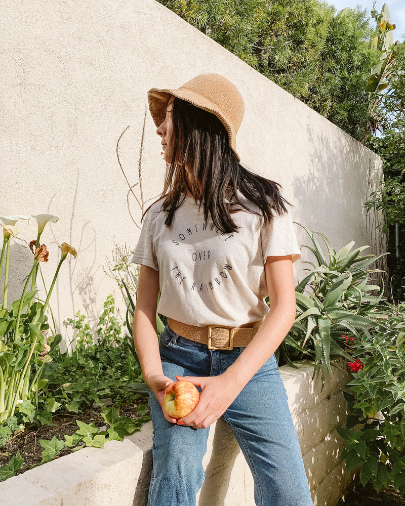 square bamboo belt with graphic tee in garden