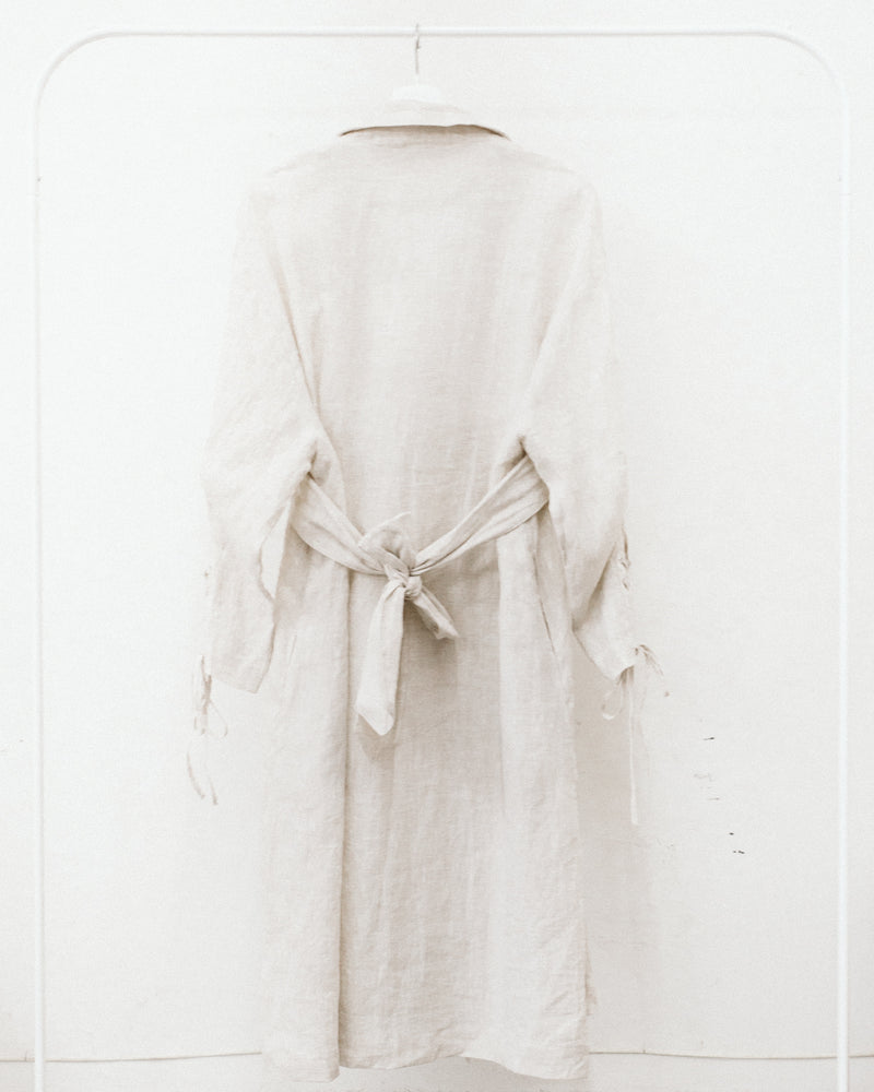 ivory linen trench coat with double breasted buttons