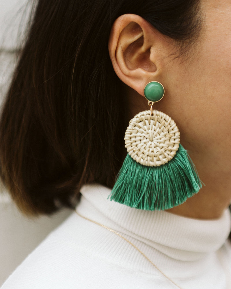 statement earrings with woven straw disc and green tassels
