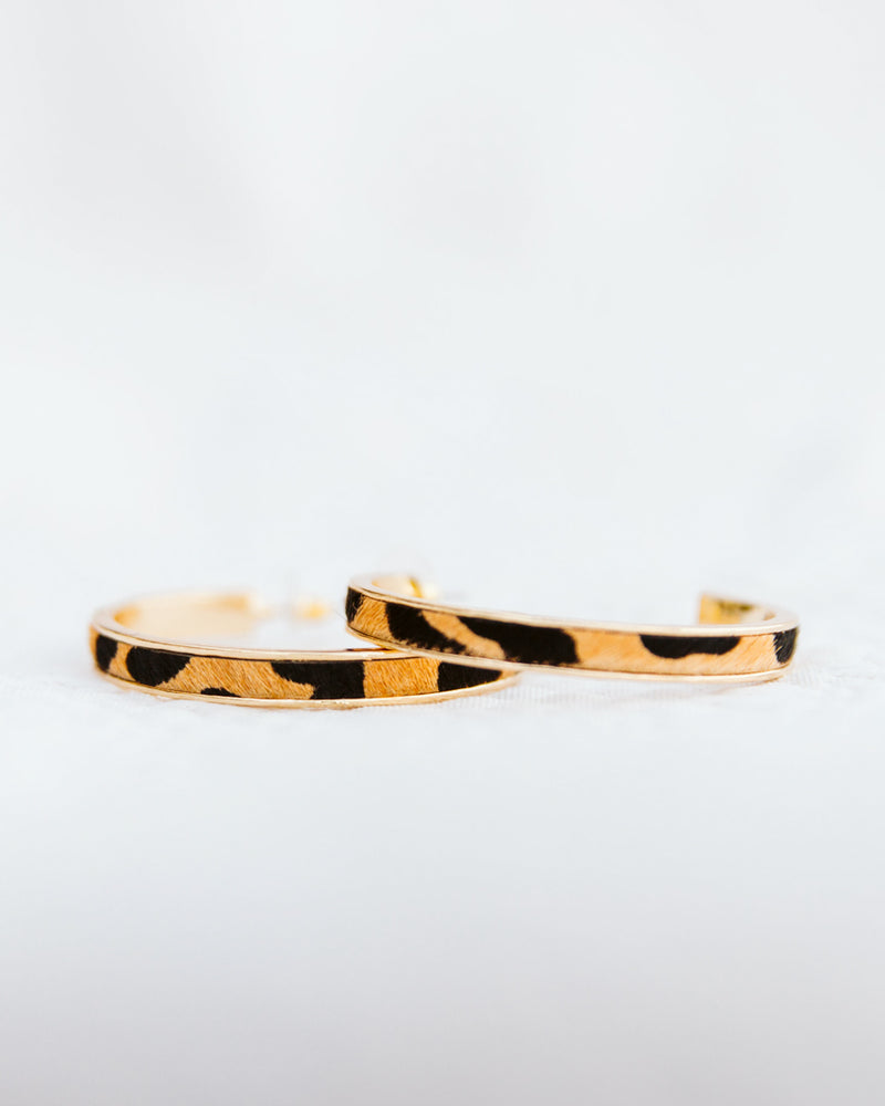 detail of gold leopard hoop earrings