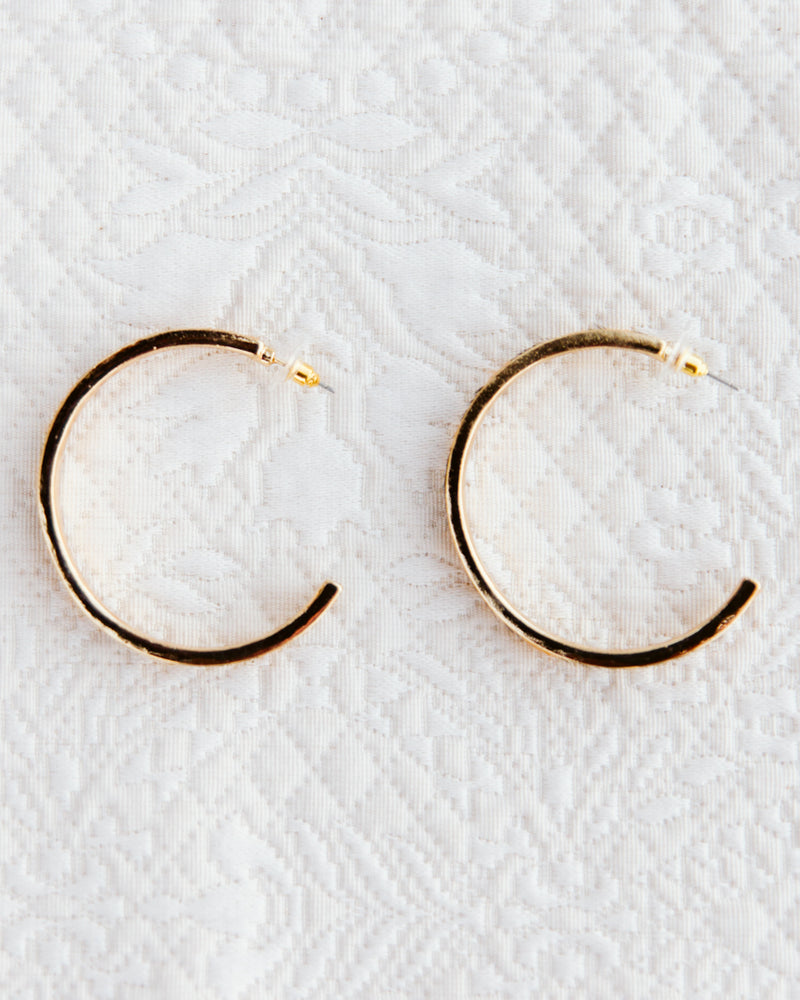 side view of gold leopard hoop earrings