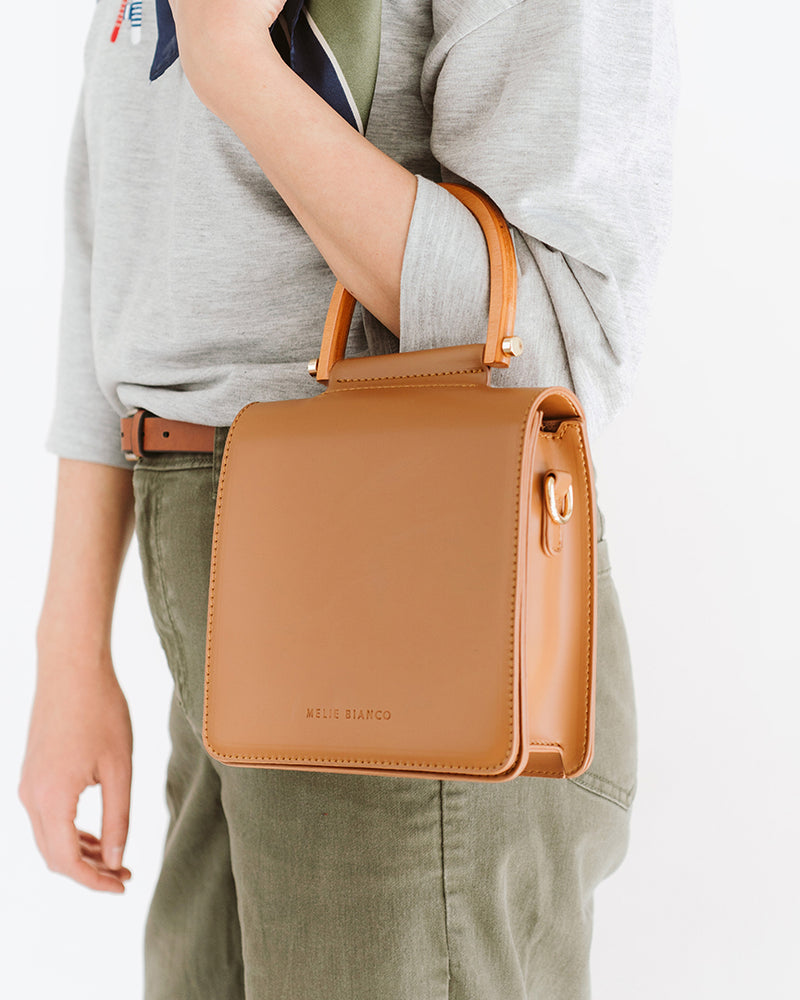 camel tan rectangle vegan leather purse with wood handle