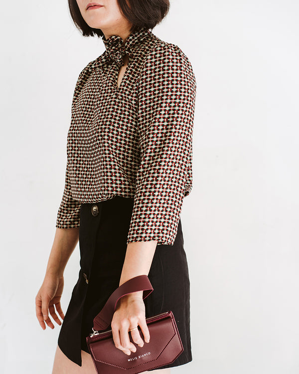 patterned tie neck collar with asymmetrical keyhole cutout